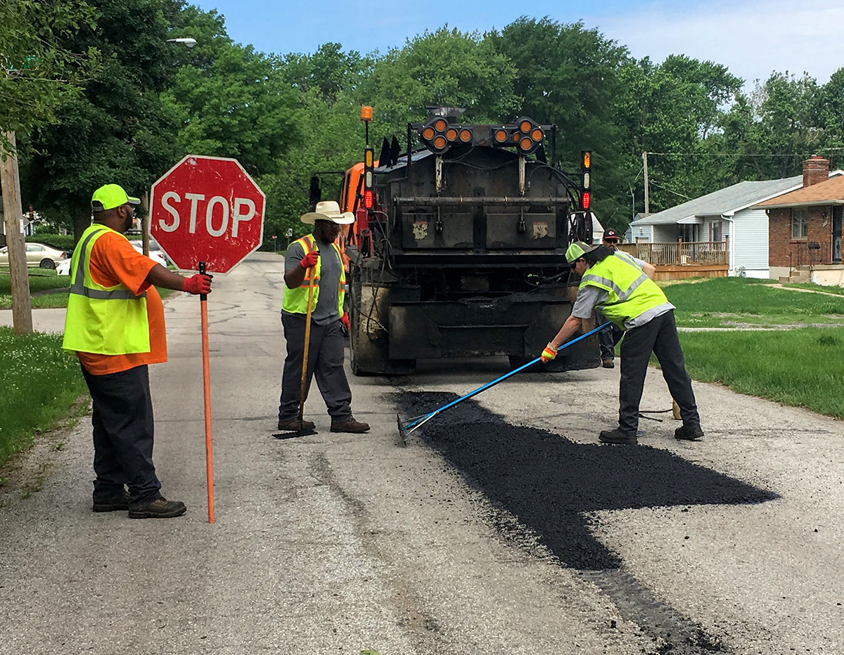 City workers filling pothole